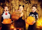 Three children in halloween costumes