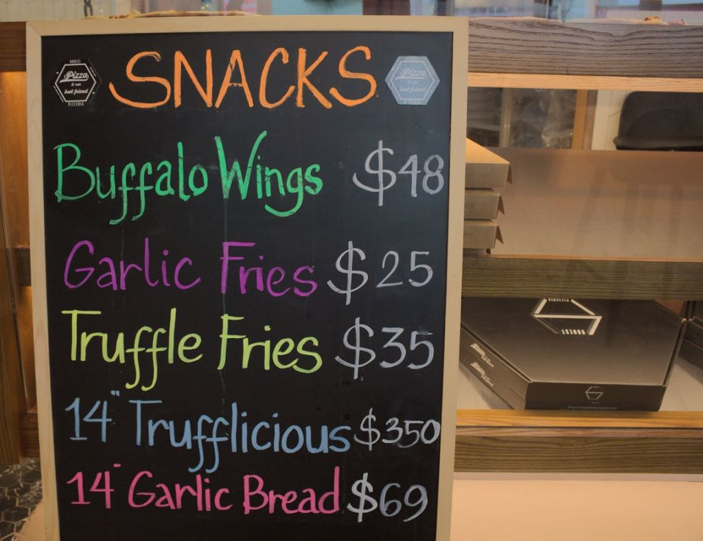 A pricelist if snacks at Honest Pizzeria in Taipa Macau