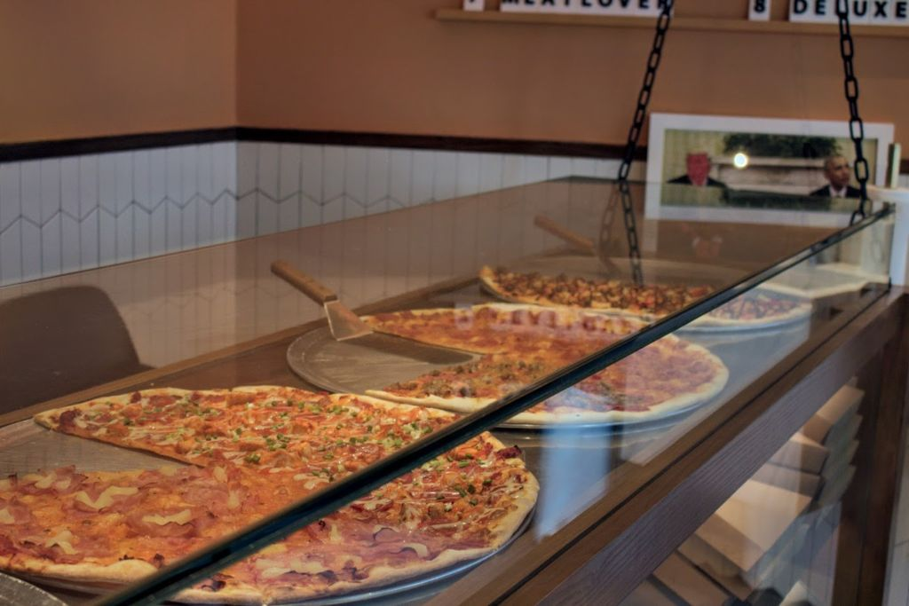Front counter display of pizzas at Honest Pizzeria in Taipa Macau