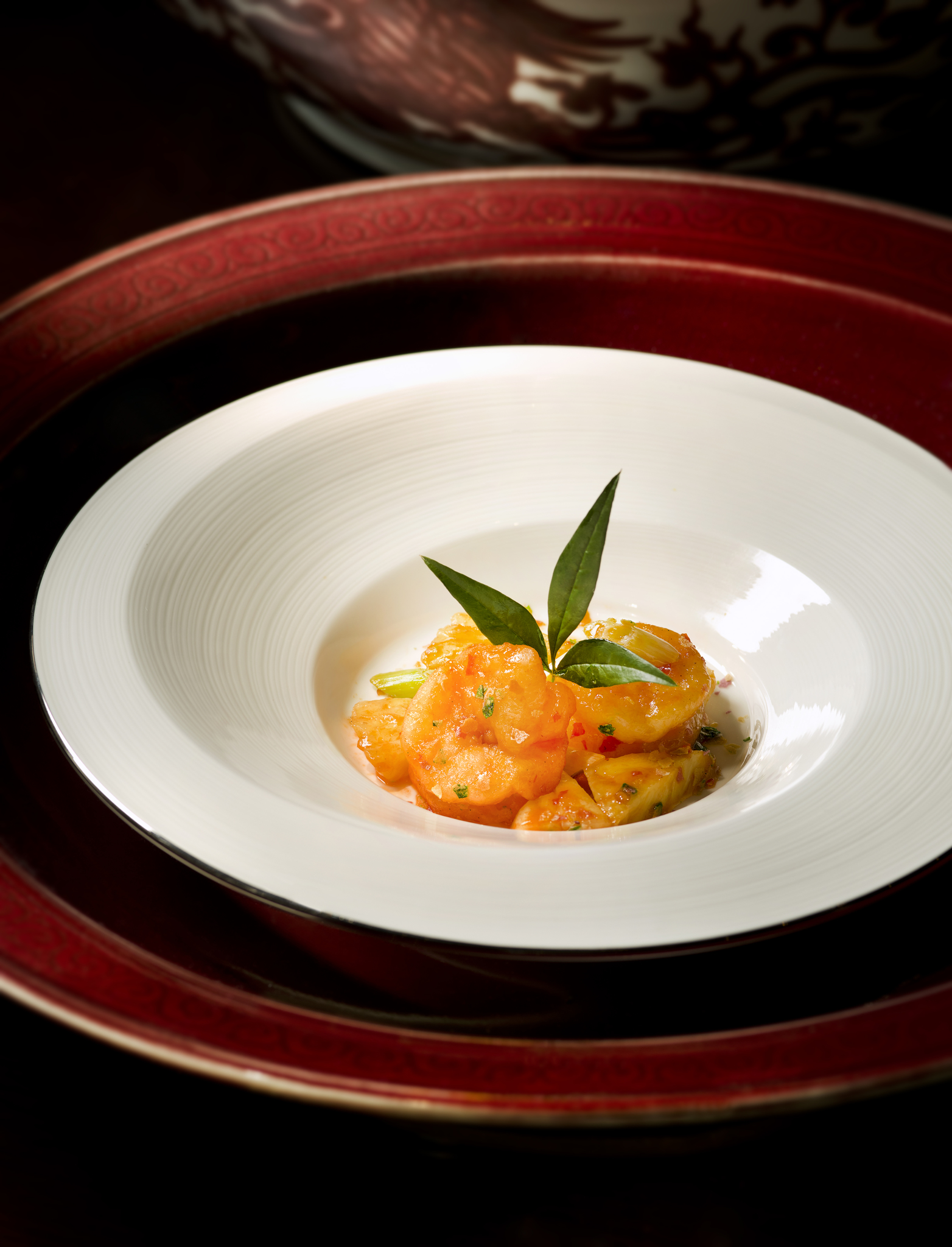 Lai Heen's pan-seared prawn with pineapple in grain white wine sauce