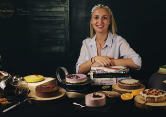 Andreea posing with some of her raw cakes.