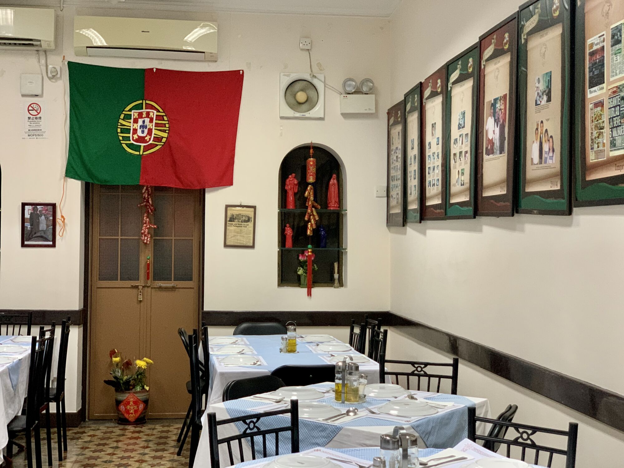 O Santos Restaurant Indoors Tables Upstairs with Portuguese Flag on the Wall Wide Macau Lifestyle