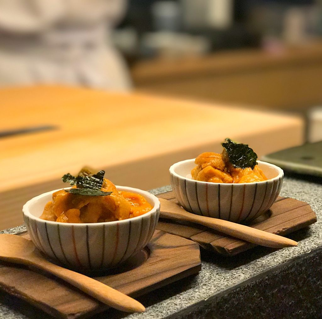 Japanese cuisine presented on wooden plates