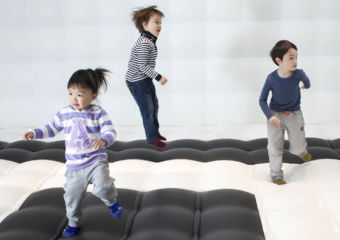 Three children playing in a bouncy area at Kids City in City of Dreams in Macau