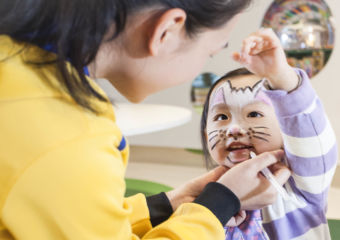 A girl receiving face paint at Kids City in City of Dreams in Macau