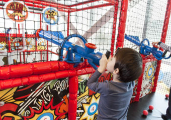 Two boys target shooting with toy guns at Kids City in City of Dreams in Macau