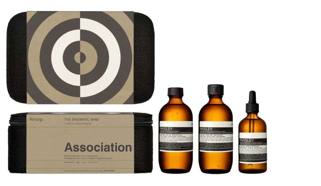 A skin treatment set in three different bottles and a carrying case.