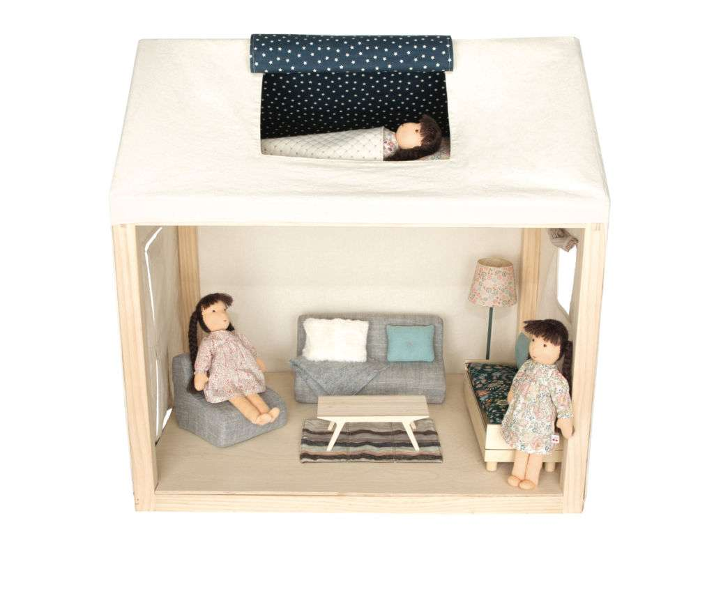A dollhouse with two dolls inside.