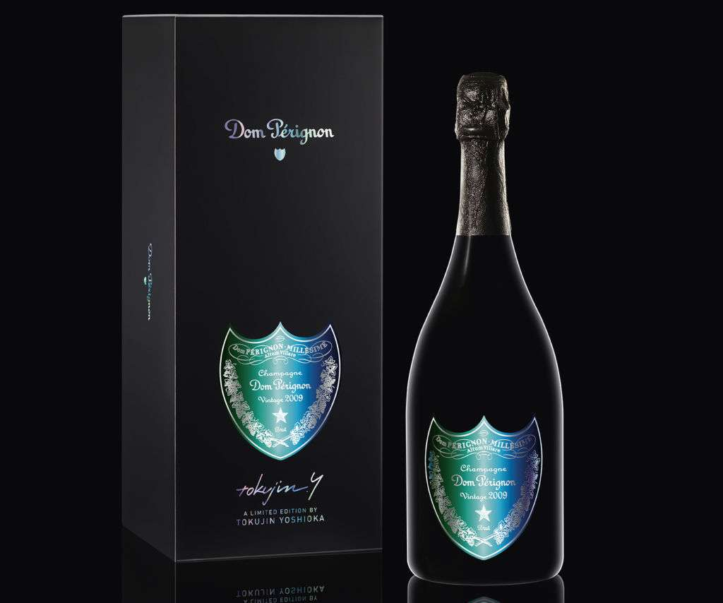 A bottle and the outside box of Dom Pérignon champagne.