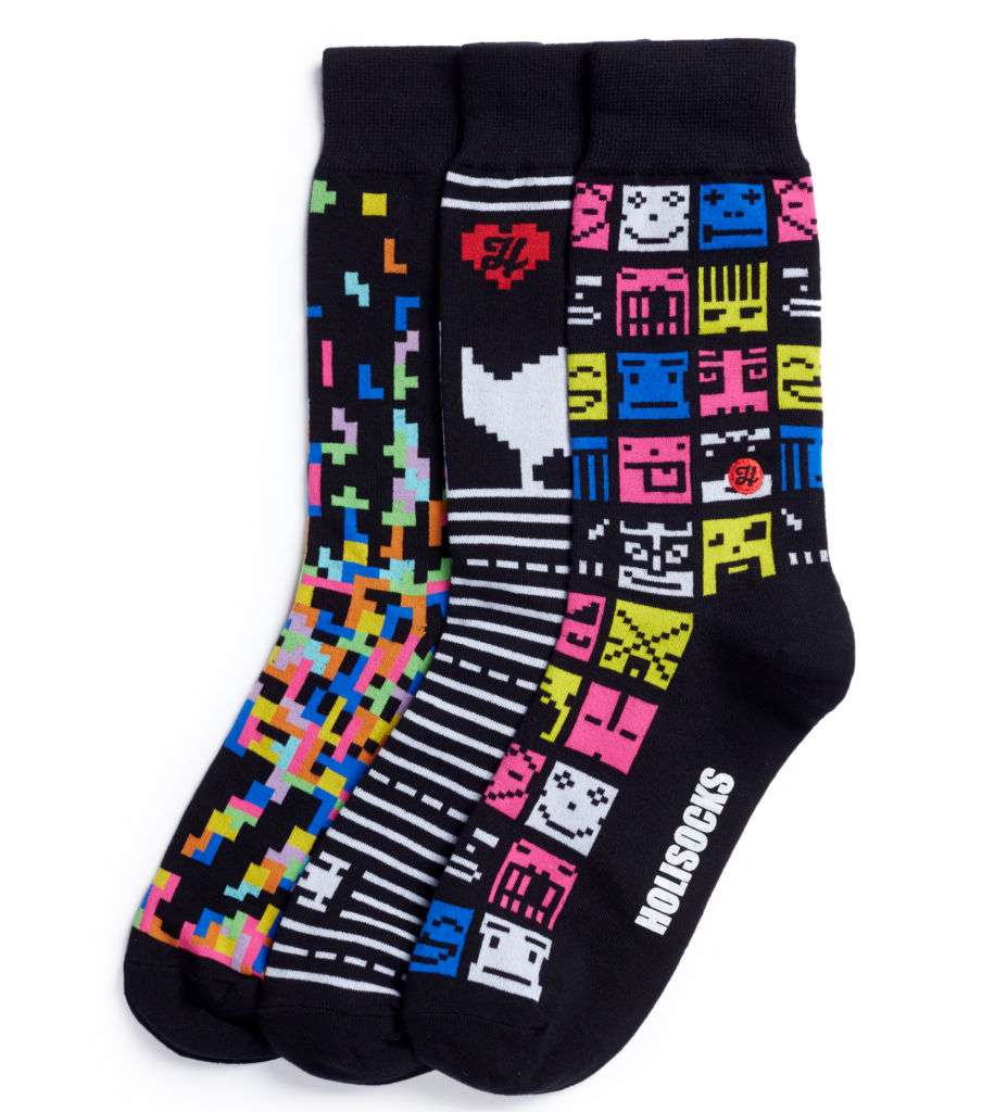 Three pairs of black socks with 8-bit computer game-style designs.
