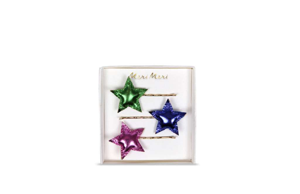 A set of star-shaped hair clips.