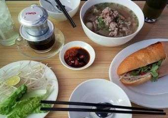 An array of Vietnamese dishes on a table.