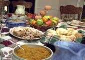 A table laid out with common Thanksgiving side dishes.