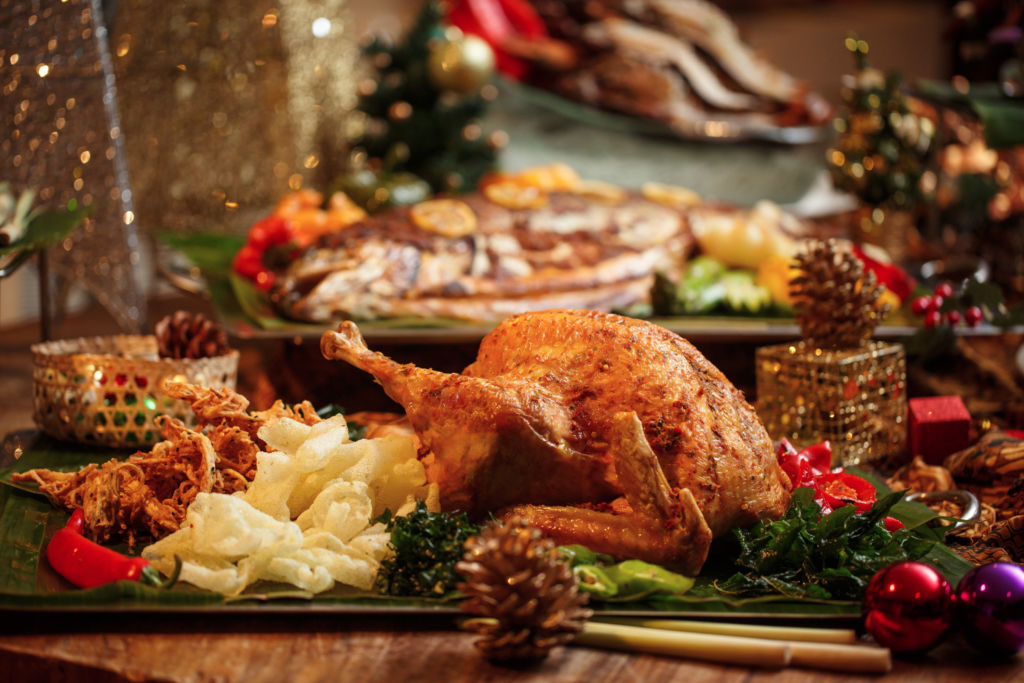 A roast turkey with other side dishes.