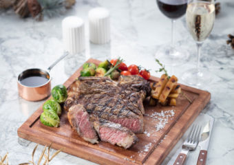 Steak on a wooden cutting board.