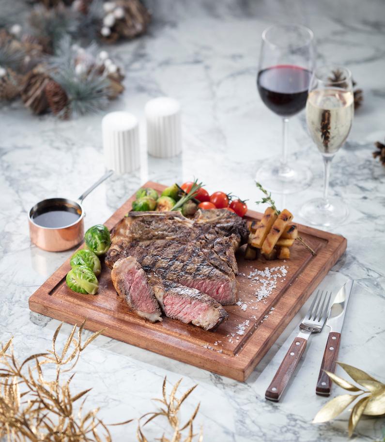 Steak on a wooden cutting board.