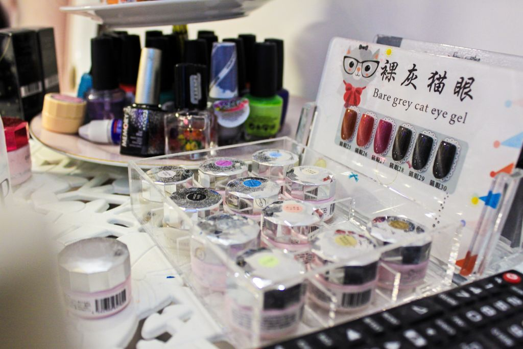 Close up shot of nail polishes and supplies.