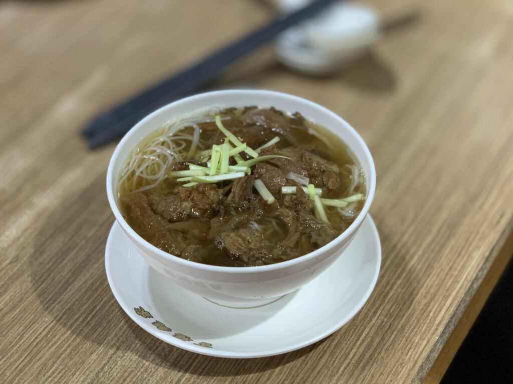 Pacapio Good Fortune Beef Noodles on the Table Distorted Background Macau Lifestyle