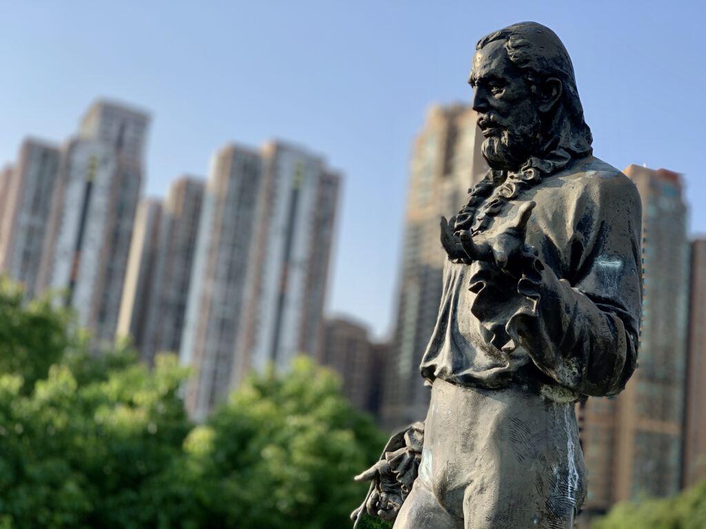 Camoes Statue Close Up with Buildings on Taipa Municipal Garden Macau Lifestyle