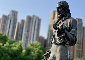 Camoes Statue Close Up with Buildings on Taipa Municipal Garden Macau Lifestyle