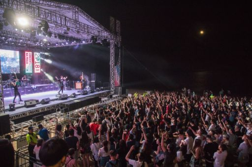 hush music festival at night, crowds
