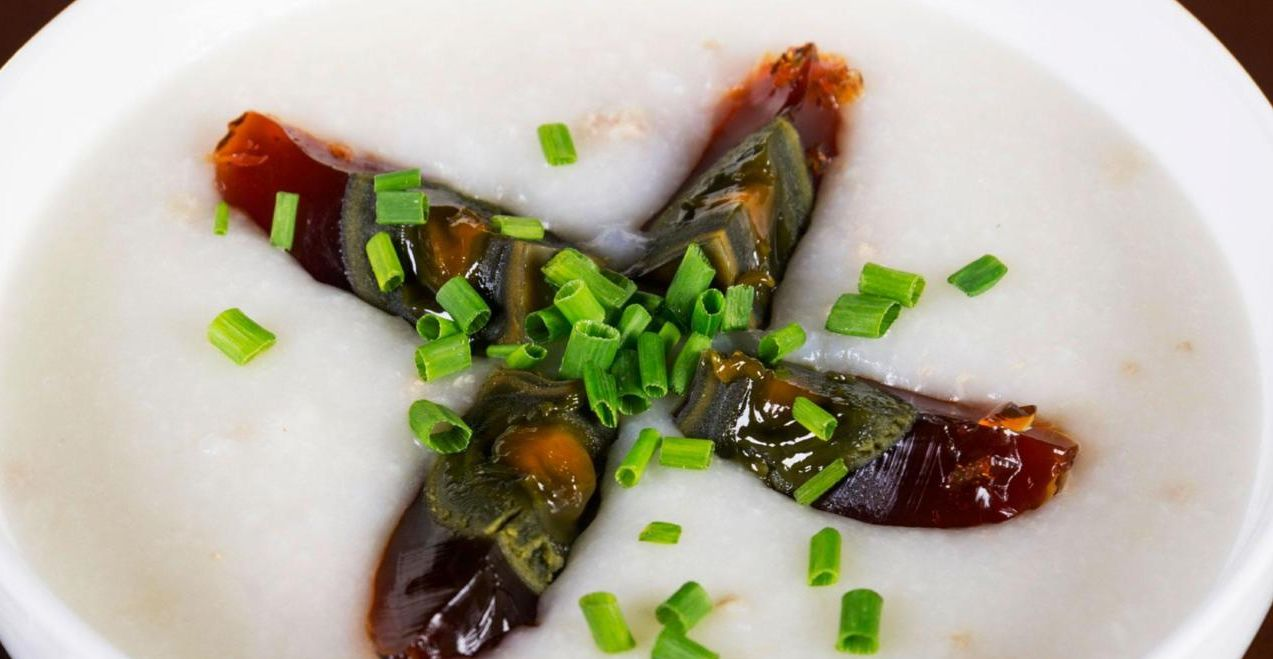 Macau dishes century egg congee