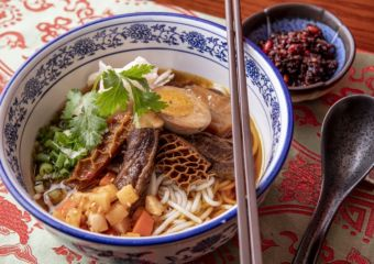 Rice noodle soup with braised beef, tripe and pickled vegetable