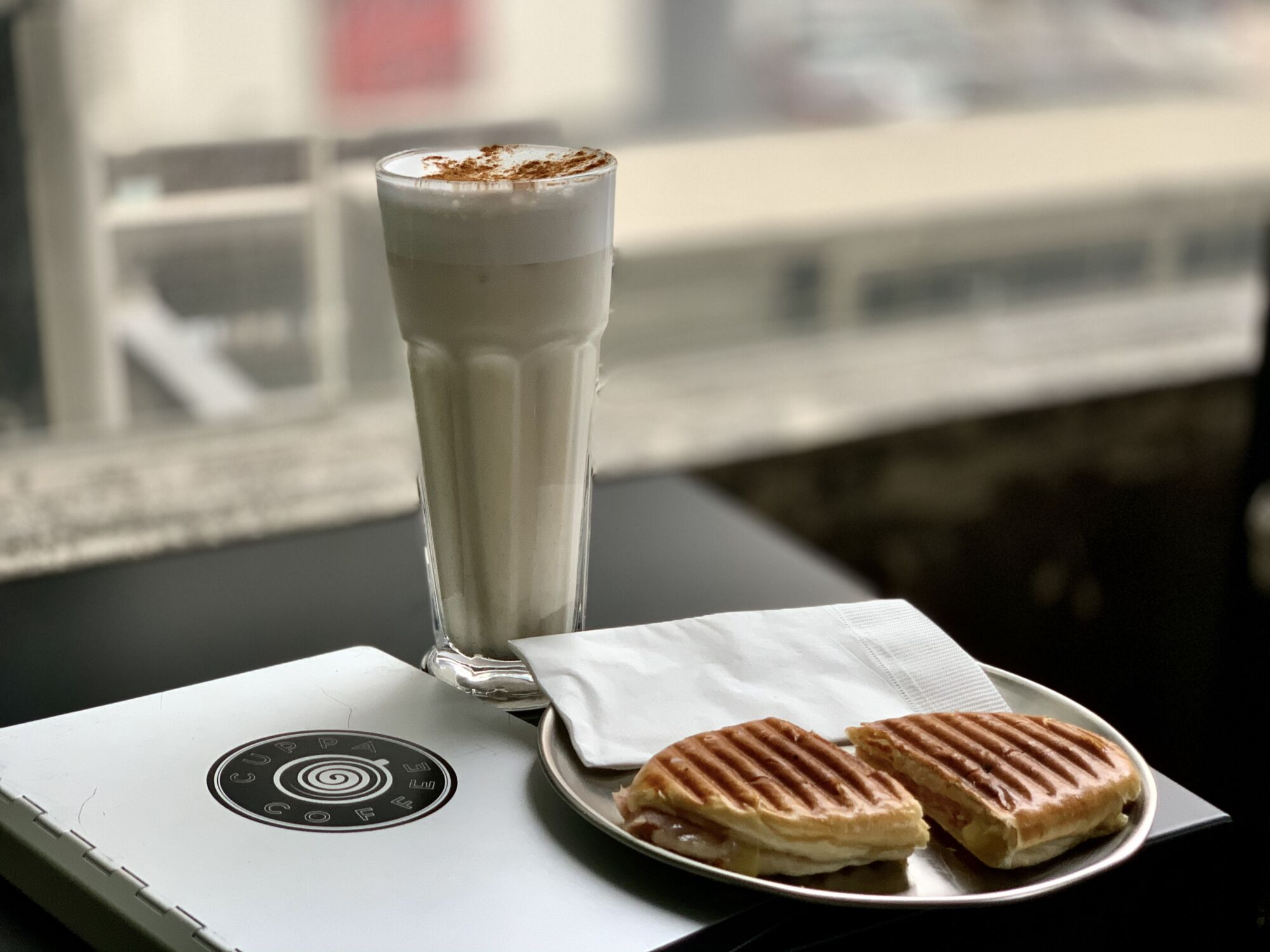 Chai Latte and Portuguese Milk Bun Photo on the Table at Cuppa Coffee Macau Lifestyle