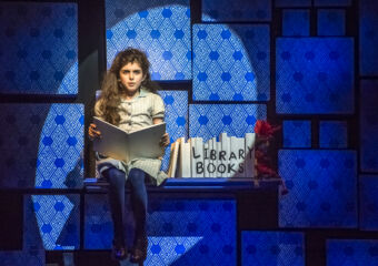 Matilda CCM Main Actress Sitting on Stage