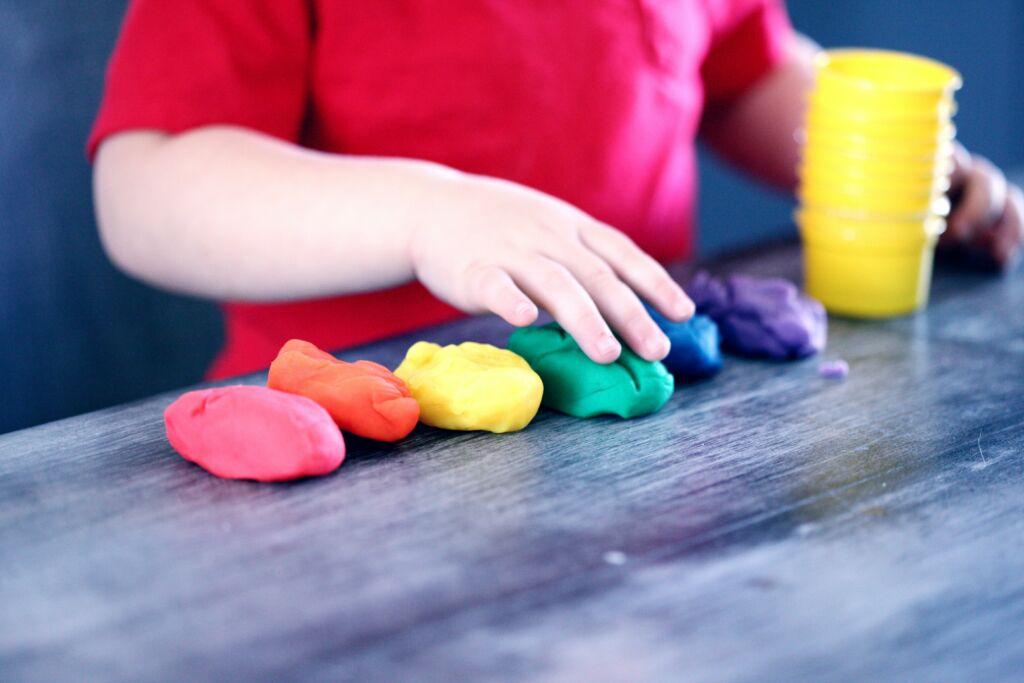 Kid using play dough