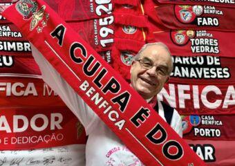 Santos O Santos Comida Portuguesa holding a SL Benfica scarf