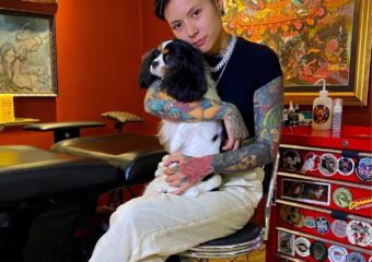 Muse Tattoo Owner Holding a Dog