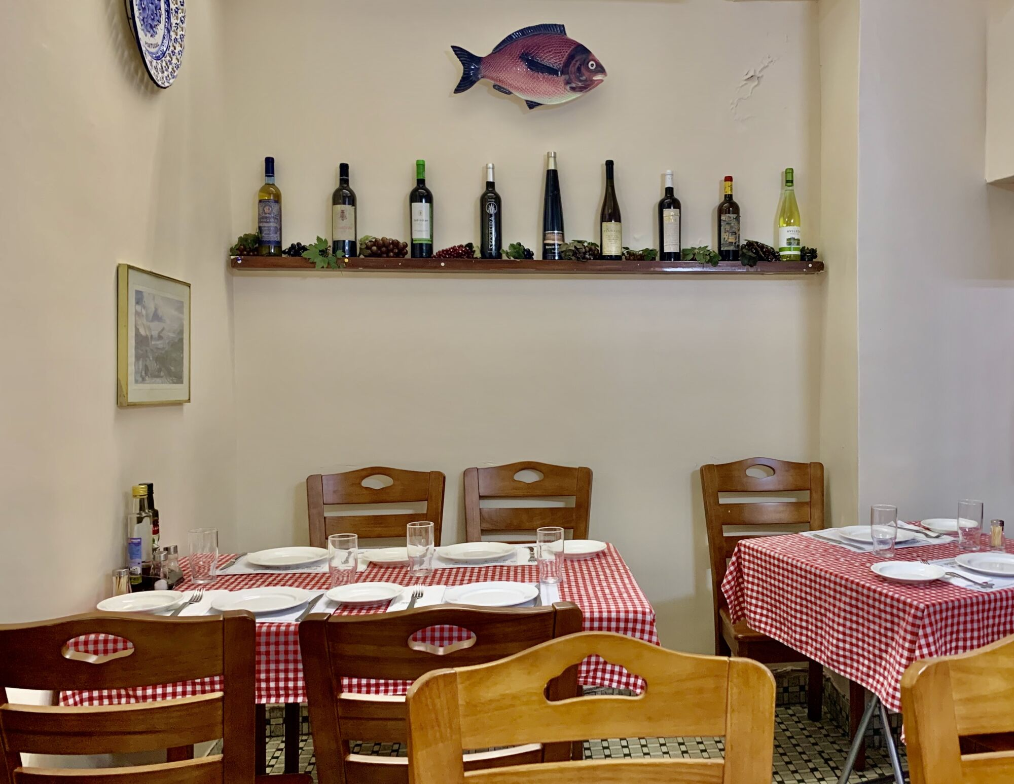 Petisqueira Interior Decorations and Bottles in the Wall Plus Tables with Chequered Cloths Macau Lifestyle
