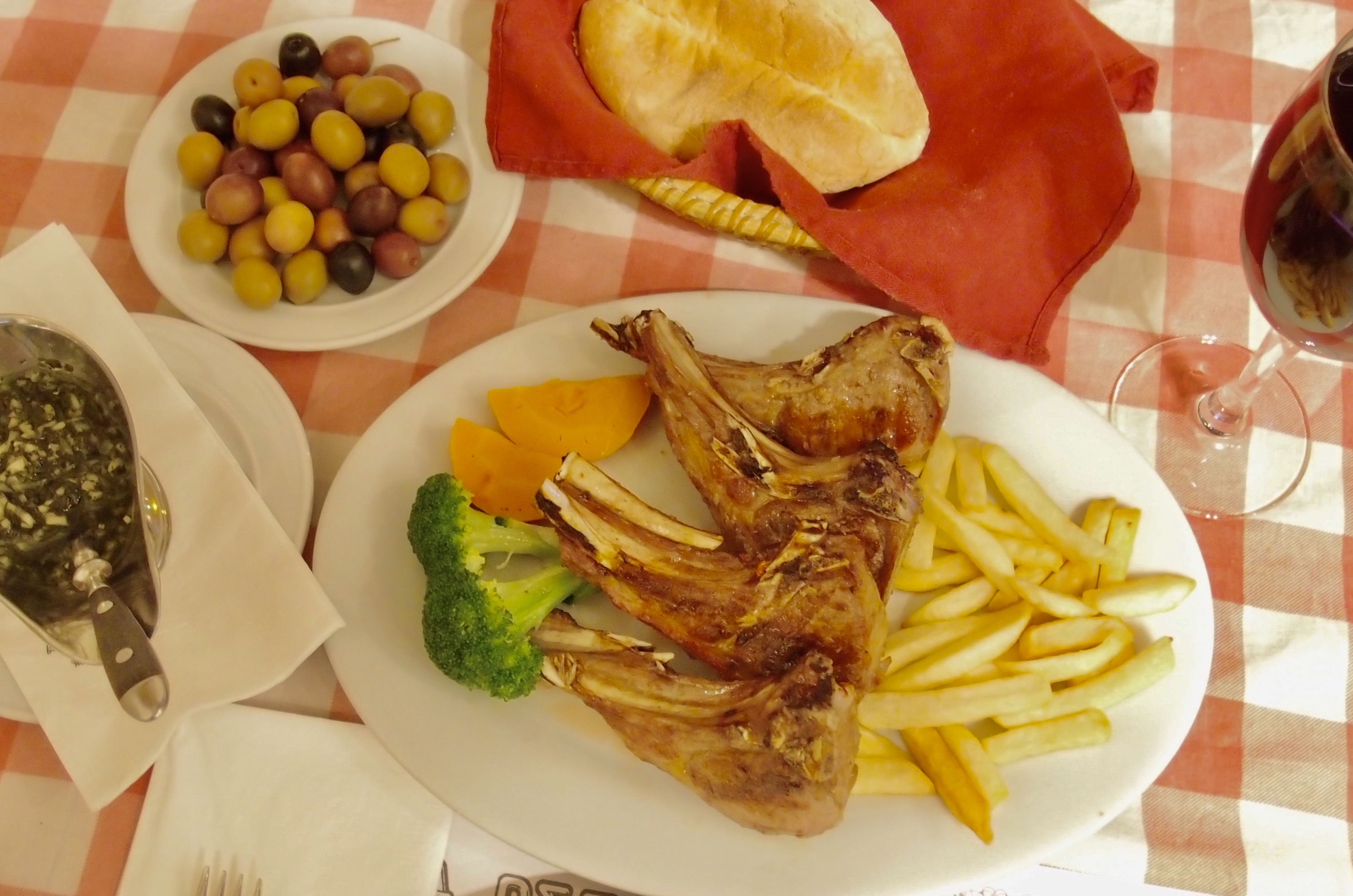 Petisqueira Interior Lamb Chops on top of a Chequered Table Cloth Credits Petisqueira