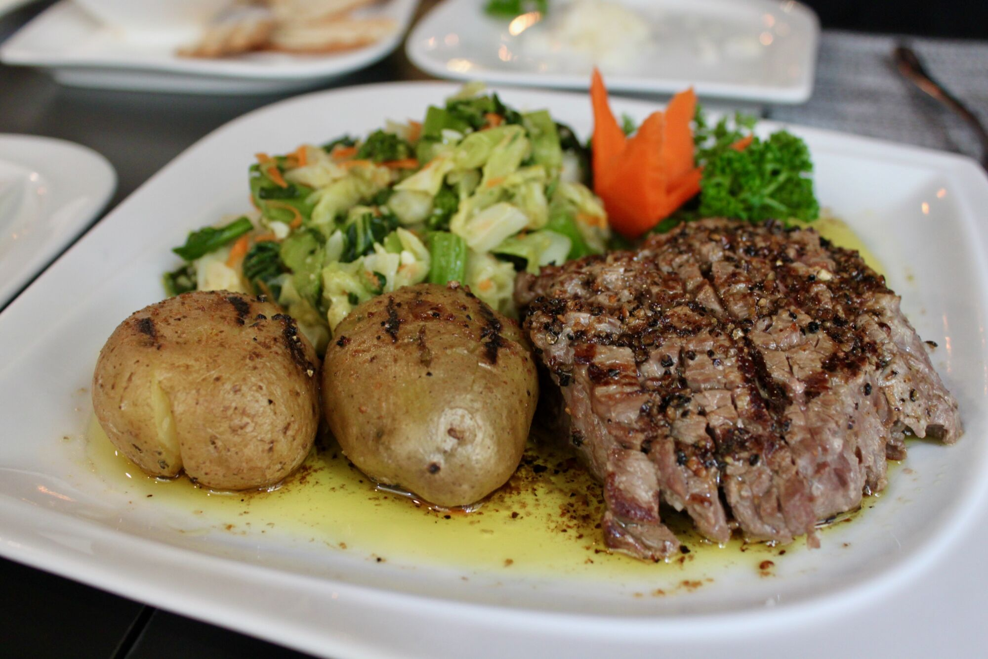 mariazinha portuguese restaurant macau sliced veal with olive oil garlic black pepper and potatoes baked with skin