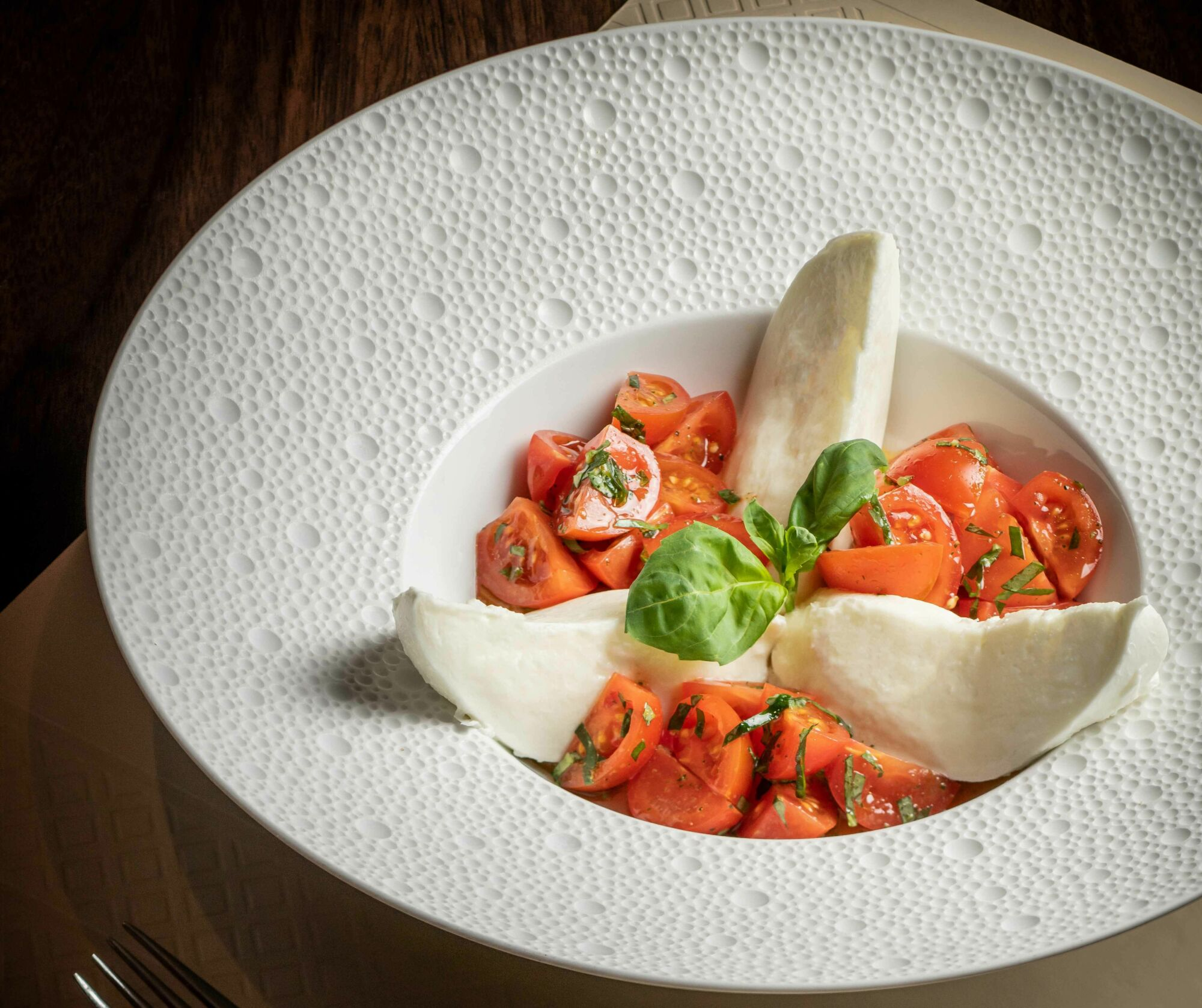 Casa don Alfonso Caprese Salad with fresh buffalo mozzarella, fresh basil and cherry tomato