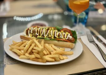 Capriccio Restaurant Hot Dog with Drink in the Background Macau Lifestyle