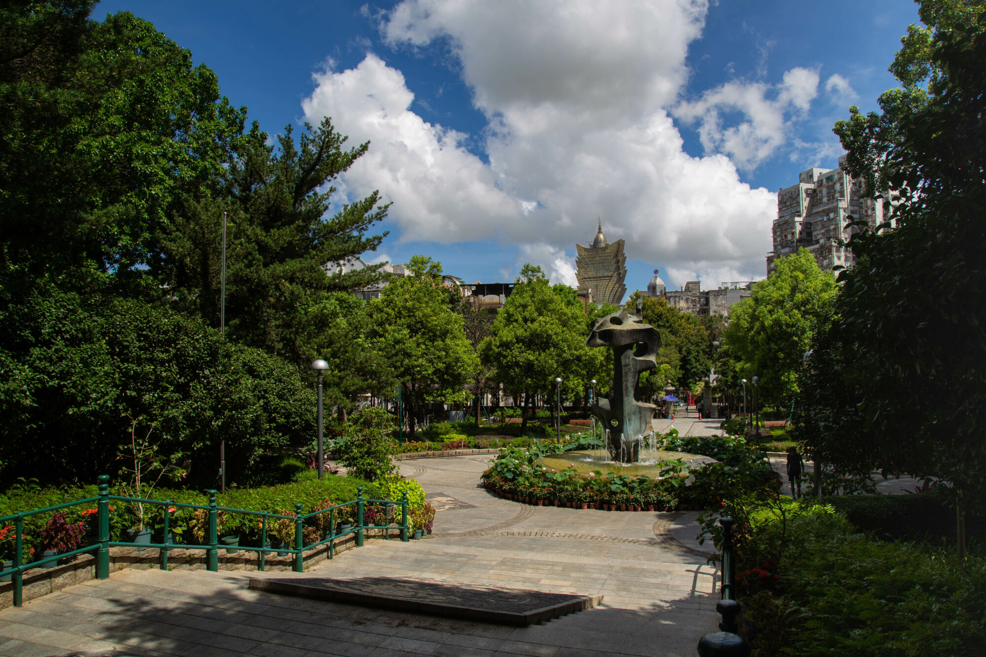Wide shot showing the front garden and back of a statue at Camoes Garden