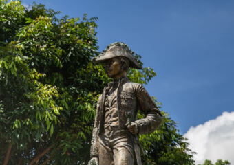 Statue found at Front view of the exterior of the Casa Garden Building
