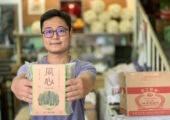 Cheong Kei Noodles Owner with Blurred Noodles in Hand Macau Lifestyle