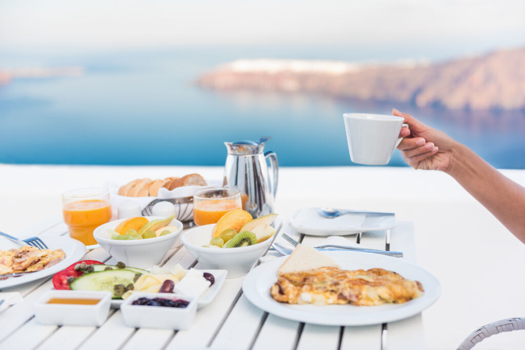 Morning person drinking coffee at breakfast table