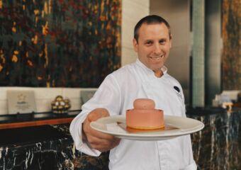 chef sebastien bernie holding pink bloom cake mandarin oriental macau