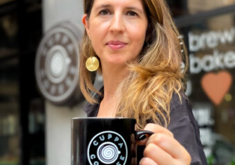 Cristiana Figueiredo from Cuppa Coffee with Coffee Cup in Hand Photo Credits Cassia Schutt