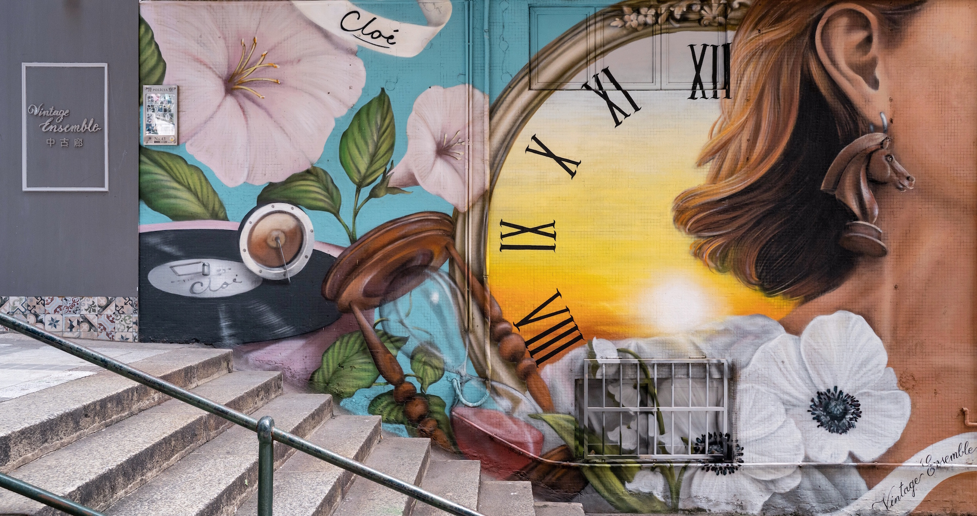 Vitorino Vong Wall Paint of a Clock and a Woman on Stairs Outside