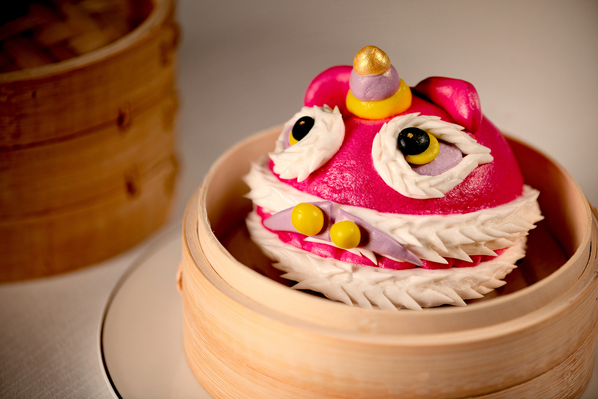 Chún and Imperial Court Steamed Lion bun with red bean and 10 years tangerine peel