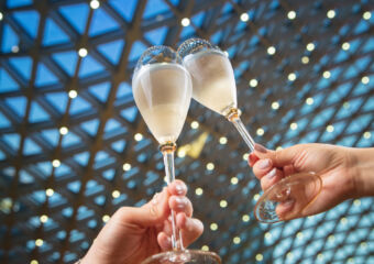 Saturday Champagne Night at Anytime MGM Cotai with Champagne Glasses in Hand and the Spectacle as Background