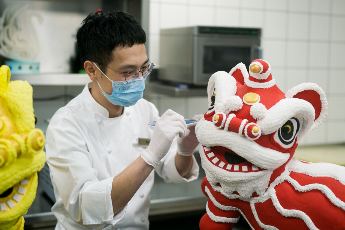 MGM Culinary Craftsmanship Chef Neo Ng decorating lion chocolate sculpture