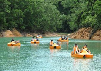 People riding pedal boats in a lake Outdoor activities kids macau